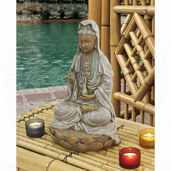 Goddess Guan Yin Seated On A Lotus Statue