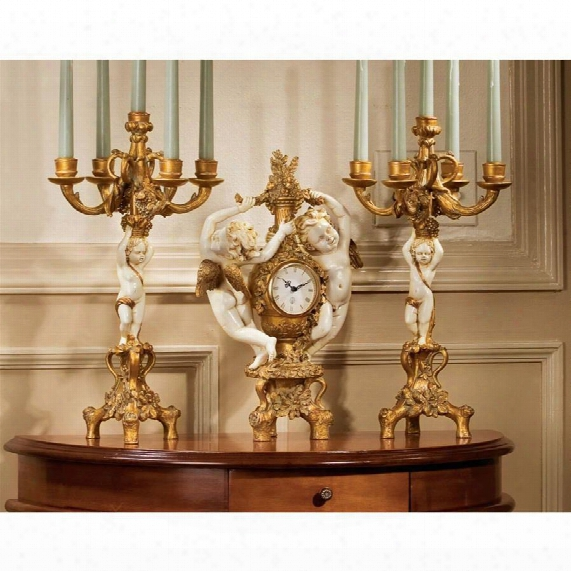 The Cherub's Harvest Clock And Candelabra Ensemble