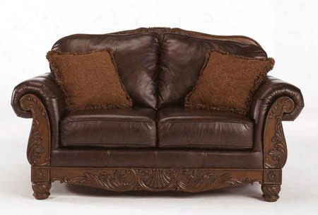 "North Shore 2260335 69"" Stationary Leather Wood Frame Loveseat With Fringed Pillows Ornate Carvings On The Frame Arched Back And Rolled Arms In Dark Brown"