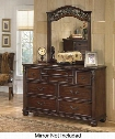 "Leahlyn B526-31 59"" 7-Drawer Dresser with Ornate Bail and Knob Handles Fluted Pilasters and Leaf Form Corbels in Warm"