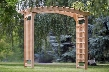 "PA106 87"" Pagoda Wedding Arbor with Lattice Sides Western Red Cedar Construction Sanded Finish and Hand"