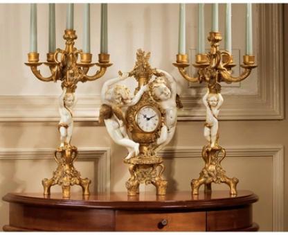 The Cherub's Harvest Clock And Candelabra Ensemble